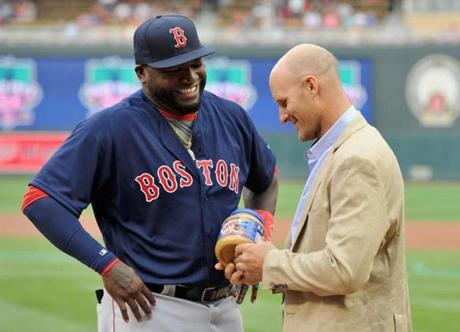 MINNEAPOLIS, MN - JUNE 10: David Ortiz #34 of the Boston Red Sox is presented with peanut butter from former teammate Corey Koskie before the game between the Minnesota Twins and the Boston Red Sox on June 10, 2016 at Target Field in Minneapolis, Minnesota. (Photo by Hannah Foslien/Getty Images)