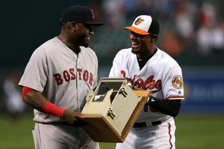 BALTIMORE, MD - SEPTEMBER 22: Adam Jones #10 of the Baltimore Orioles presents David Ortiz #34 of the Boston Red Sox with the dugout telephone Ortiz broke on July 27, 2013 during his retirement ceremony at Oriole Park at Camden Yards on September 22, 2016 in Baltimore, Maryland. (Photo by Matt Hazlett/Getty Images)