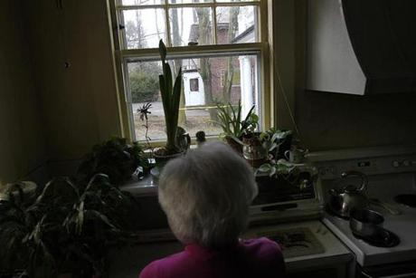 Harriet Allen lives next door to the home where the two elderly sisters lived. This is the kitchen window where she could see them, now and then.