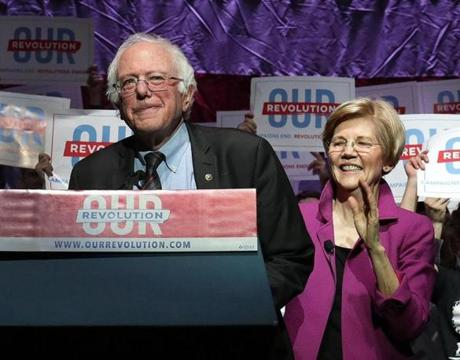 Boston, MA - 3/31/2017 - U.S. Senator Bernie Sanders is introduced by U.S. Senator Elizabeth Warren . (Barry Chin/Globe Staff), Section: Metro, Reporter: Globe Staff, Topic: 01sanders, LOID: 8.3.2071686337.