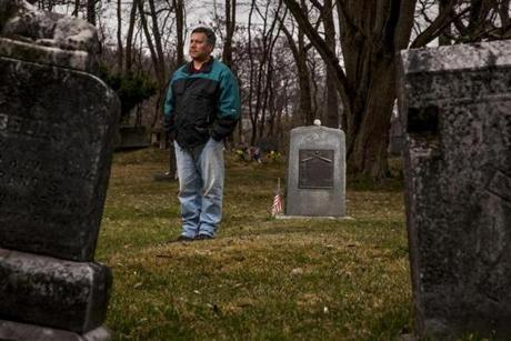 Indian Island, ME 4/21/17 11:25:41 AM Chris Sockalexis, a descendant of Louis Sockalexis, at his grave on the Penobscot Nation Indian Island Reservation in Indian Island, Maine, on Friday, April 21, 2017. Louis Sockalexis played baseball for Cleveland in the 1890s, and the Cleveland Indians' current logo is believed to be based on him. The Penobscot tribe wants the team to do away with the logo. (Sarah Rice for The Boston Globe)