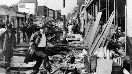 Boston, MA - 6/1/1967: Officers look over the aftermath of riots on Blue Hill Avenue in the Roxbury neighborhood of Boston, June 1967. (William Ryerson/Globe Staff) --- BGPA Reference: 140909_MJ_014