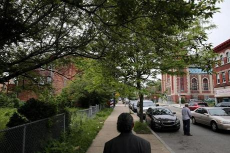 Boston, MA- May 31, 2017: Representative Byron Rushing tours the 300 block Blue Hill Ave in Roxbury, MA on May 31, 2017. The vacant lot at left was once the Operation Exodus office. A sit-in by welfare mothers at the Grove Hall Welfare office in 1967 kick-started a weekend of rioting and unrest on Blue Hill Ave 50 years ago. Rushing was a community organizer who was arrested in the turmoil. (Globe staff photo / Craig F. Walker) section: metro reporter: Johnson