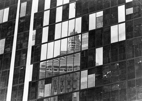 Boston, MA - 8/8/1973: Many black-painted plywood boards cover the windows of the John Hancock Tower in Boston on Aug. 8, 1973. High winds had broken and damaged much of the glass facade over time. (Joe Dennehy/Globe Staff) --- BGPA Reference: 141020_CB_025
