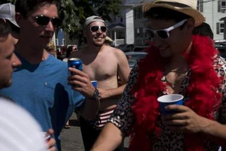 Gloucester, MA - 6/25/17 - Randy Sweet, the winner of Friday's and Saturday's greasy pole competition, arrives at a house party during the St. Peter's Fiesta in Gloucester, Mass. on Sunday, June 25, 2017. Each year a select group of men, some novices, others seasoned champions, compete against each other to see who can run across a telephone pole layered in grease and suspended over the sea. This year after one full round, Gloucester resident, Jake Wagner, grabbed the flag, claiming victory. (Nicholas Pfosi for The Boston Globe) Reporter: Billy Baker Topic: 02greasypole(2)