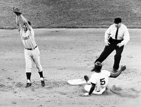 Boston, MA - 7/17/1967: Boston Red Sox player George Scott steals second base during a game against the Detroit Tigers at Fenway Park in Boston on July 17, 1967. Tigers shortstop Ray Oyler attempts to reign in the throw. (Dan Goshtigian/Globe Staff) --- BGPA Reference: 170216_MJ_009