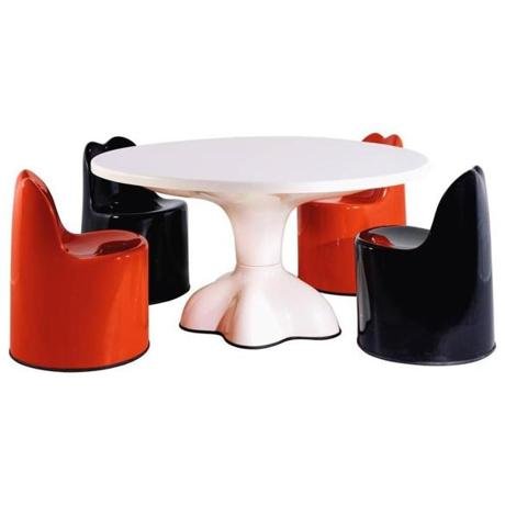 Considered the father of American art furniture, Wendell Castle (born 1932) is known for the rounded, sculptural pieces he's been creating since the early 1960s. This original-production Molar Group dining set (1969), made of gel-coated red, black, and white Fiberglas, is offered through a dealer online at 1stdibs for $29,000.