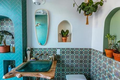 "Justina Blakeney, the Los Angeles-based writer behind the bohemian-style blog ""The Jungalow,"" chose Moroccan-inspired Fireclay Tile for her recent master bathroom redesign, along with Kohler fittings and fixtures. The colors and patterns, along with her proclivity for houseplants, creates a vibe reminiscent of late 1960s -early 1970s global-influenced design. ""Global pieces were becoming more and more incorporated into the décor as the '60s progressed,"" Blakeney said."