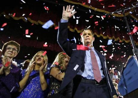 (R-L) Marty Walsh celebrates with his longtime partner Lorrie Higgins, her daughter, Lauren, and his mother, Mary, at his Election night party at the Park Plaza hotel in Boston, Massachusetts November 5, 2013. (Jessica Rinaldi For The Boston Globe)