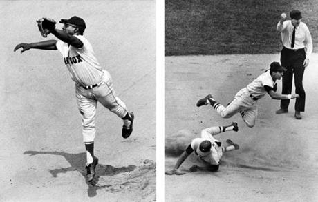 Boston, MA - 7/13/1967: Baltimore Orioles player Sam Bowens is called out at second base during the sixth inning of the first game of a double header against the Boston Red Sox at Fenway Park in Boston on July 13, 1967. Red Sox shortstop Rico Petrocelli is airborne above him. (Dan Goshtigian/Globe Staff) --- BGPA Reference: 170322_MJ_024 Boston, MA - 7/15/1967: Boston Red Sox third baseman Joe Foy reaches out for a hit in the sixth inning of a game against the Baltimore Orioles at Fenway Park in Boston on July 15, 1967. (Dan Goshtigian/Globe Staff) --- BGPA Reference: 170322_MJ_025