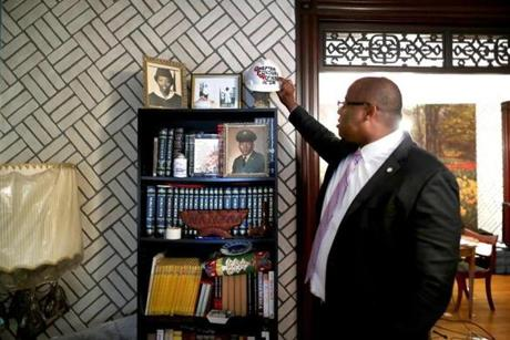 Tito Jackson placed a hard hat on a shelf in his living room graced with photos of his mother, Rosa, and his uncle Claver.