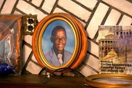 A framed photograph Tito Jackson as a child sat above a couch in the living room of the house where he grew up.