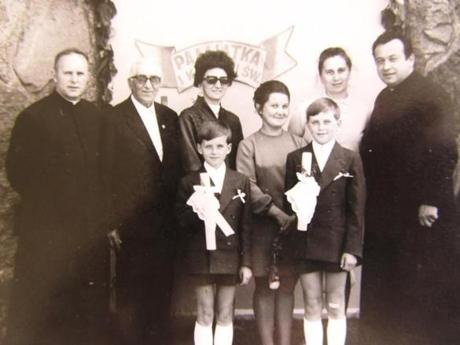 Janusz Kowalski (cq) (bottom row, left boy) with his father, the Rev. Boleslaw Petlicki (cq) (far left). His mother Regina Kowalska (cq) , back row 2nd from far right.