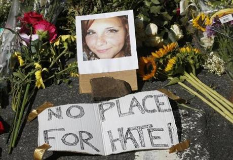 A makeshift memorial of flowers and a photo of victim, Heather Heyer, who was killed when a car rammed into a group of people who were protesting the presence of white supremacists who had gathered in Charlottesville, Va., in August.