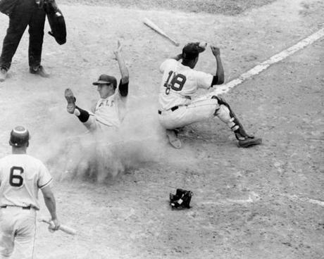 California Angels infielder Bob Knoop slide in safely at home during the second inning of the second game of an Aug. 20 doubleheader, as the Sox quickly fell behind.