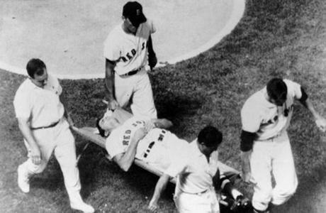 "fromthearchive / August 18 1967 / Tony Conigliaro is carried off the Fenway Park field by teammates Mike Ryan and Jim Lonborg and by trainer Buddy LeRoux and Angels' trainer Fred Federico on after being hit in the face by a Jack Hamilton pitch in the fourth inning. ""When I got to him,"" said team physician Dr. Thomas Tierney, he said: ""It hurts like hell. I heard a hissing sound and that was all."""