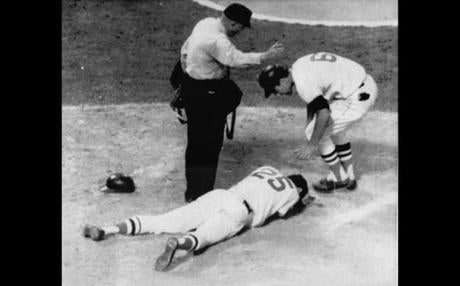 Rico Petrocelli bent over a prone Tony Conigliaro after he was hit by a pitch.