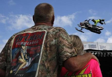 Bristol, TN -- 8/18/2017 - People watch as a Snowmobile glides through the air, part of a Freestyle Motocross Demo held for fans before the race. (Jessica Rinaldi/Globe Staff) Topic: 21NASCAR Reporter: Annie Linskey