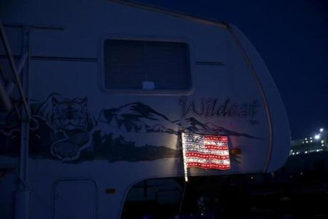 Bristol, TN -- 8/18/2017 - An American flag is illuminated as night falls in Earhart Campground, a private campground adjacent to the Speedway. (Jessica Rinaldi/Globe Staff) Topic: 21NASCAR Reporter: Annie Linskey