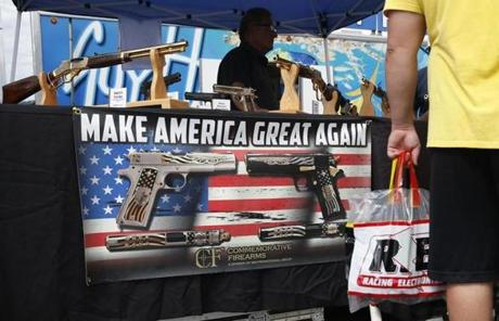 "Bristol, TN -- 8/18/2017 - Brad Ness manned the booth at Commemorative Firearms as fans stopped by to check out his guns bearing Trump's motto: ""Make America Great Again"" at the Bristol Motor Speedway. (Jessica Rinaldi/Globe Staff) Topic: 21NASCAR Reporter: Annie Linskey"
