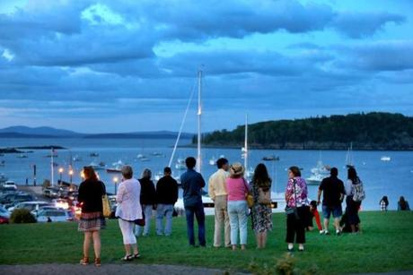 Visitors took in the view from Agamont Park in the heart of Bar Harbor's waterfront at dusk.