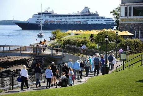 With the cruise ship Maasdam docked in Bar Harbor, visitors stroll the scenic Shore Path.