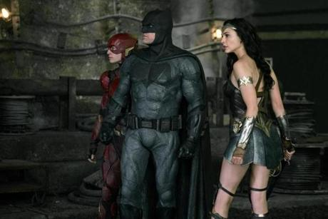 EZRA MILLER as The Flash, BEN AFFLECK as Batman and GAL GADOT as Wonder Woman in the 2017 film JUSTICE LEAGUE, directed by Zack Snyder. Credit Courtesy of Warner Bros.