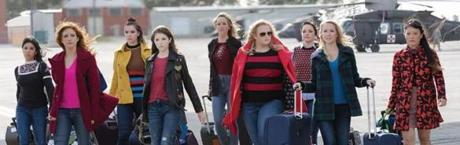 Get ready to have a Merry Pitchmas. (L to R) Flo (CHRISSIE FIT), Chloe (BRITTANY SNOW), Emily (HAILEE STEINFELD), Beca (ANNA KENDRICK), Jessica (KELLEY JAKLE), Fat Amy (REBEL WILSON), Ashley (SHELLEY REGNER), Aubrey (ANNA CAMP) and Lilly (HANA MAE LEE) in the 2017 film PITCH PERFECT 3, directed by Trish Sie.