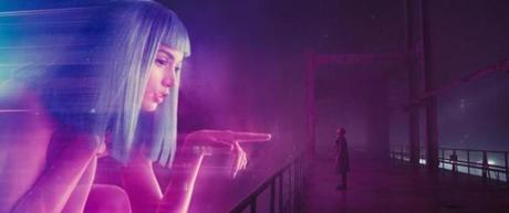 (L-R) ANA DE ARMAS as Joi and RYAN GOSLING as K in the 2017 film BLADE RUNNER 2049, directed by Denis Villeneuve.