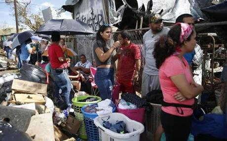 Caguas, PR -- 9/29/2017 - People waited in line for hours to do their wash at Pink Coin Laundry in Caguas. (Jessica Rinaldi/Globe Staff) Topic: Reporter: