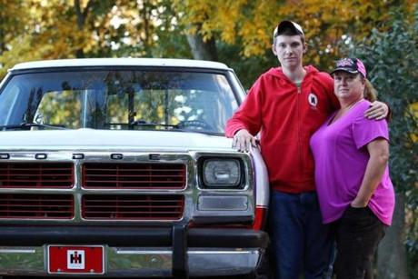 Dalton Lesley, 17, a junior at York County School of Technology, and his mother, Sue, next to the 1991 Dodge pickup he rebuilt, at their home in New Freedom, Pa.