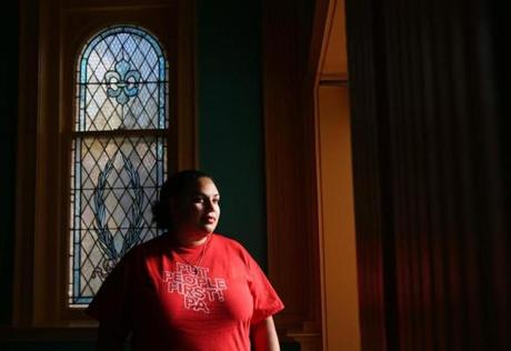Carla Christopher works with youths in a drop-in program at Union Evangelical Lutheran Church in downtown York, Pa.