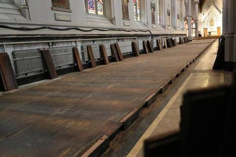 The pews have been removed; they will be refinished and re-installed.