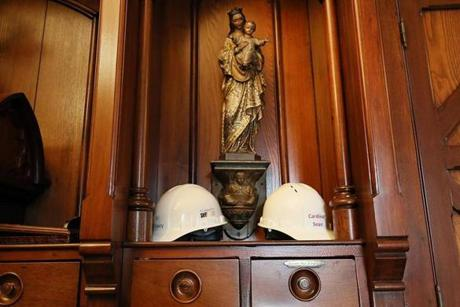 Construction hats for Father Kevin O'Leary and Cardinal Sean O'Malley were visible at the Cathedral.