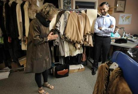 Framingham, MA., 08/15/17, At his second job, Abdulkader Hayani finishes his first fur coat project for customer Ellen Cohen Kaplan at Forever Fur. The owner and furrier had taken him under their wing, training him how to take old fur coats and turn them into lined rain coats. Suzanne Kreiter/Globe staff