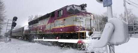Rowley, MA: 03-14-2017: Newburyport bound MBTA commuter rail train out of Boston pulls in to the Rowley station in Rowley, Mass. during March 14, 2017 snowstorm. Photo/John Blanding, Boston Globe staff story/ ( 15storm )