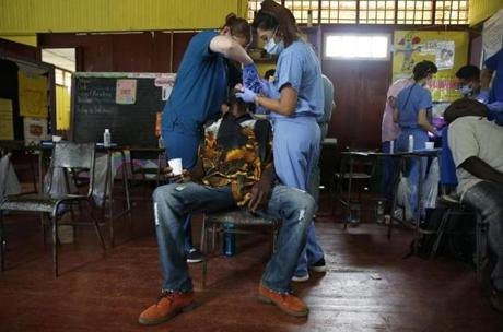Dental students worked to extract a patient's tooth inside the makeshift dental clinic in Mount Moriah.