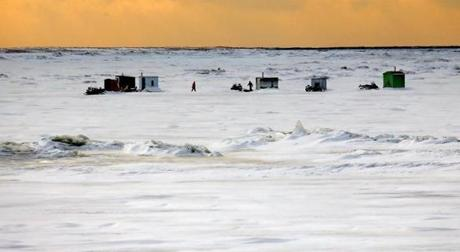 Power plants on Quebec's rivers can clash with native ways of life, such as ice fishing on the Outardes River.