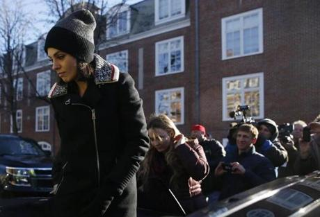 Mila Kunis arrived before the start of a parade through the streets of Cambridge.