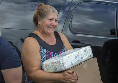 A native of Caguas is all smiles after receiving a Red Sox care package.
