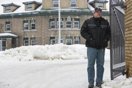 Mike Osborne, the vice president of community and economic redevelopment group Our Katahdin, stood in the driveway of the Great Norther Paper Mill.