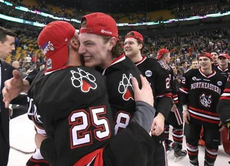 Northeastern Adam Gaudette hugged teammate Patrick Schule after the game.