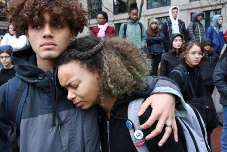 Junior Nigel Wallace comforted Freshman Aleyana Pina during the student walkout.