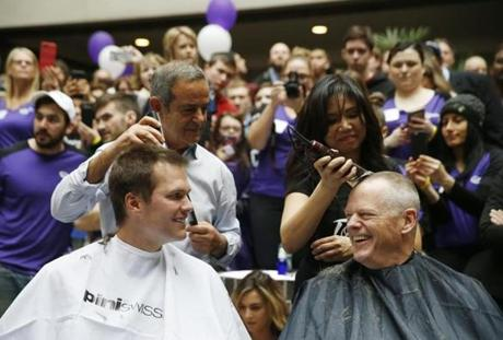 Tom Brady and Governor Charlie Baker reacted as they get their heads shaved.
