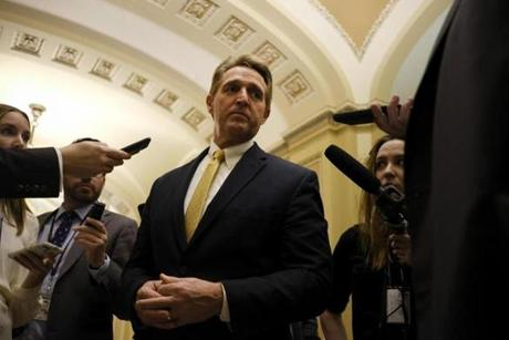 Senator Jeff Flake spoketo reporters at the Capitol in Washington.