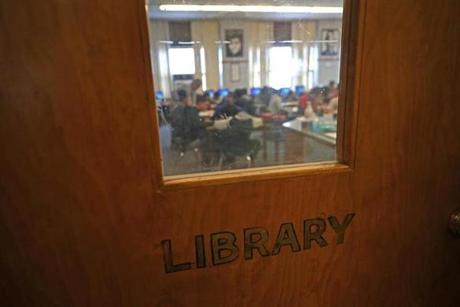 Budget cuts have hit Brockton hard. A former library at North Middle School is used as a crowded classroom.