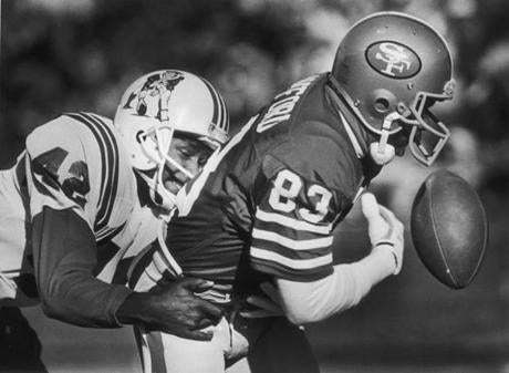 OPS photo by bill greene bw december 14 1986 pats86-87 49ers vs patriots- ronnie lippett breaks up a pass play in the first quarter, intended reciever was derrick crawford.