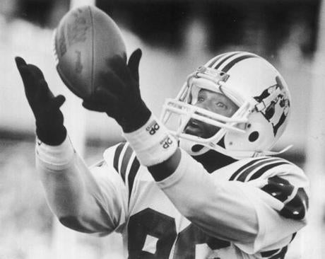 OPS PHOTO BY stan grossfeld bw february 11 1986 pats stanley morgan grabs a fifty yard td for pats first score. / new england patriots