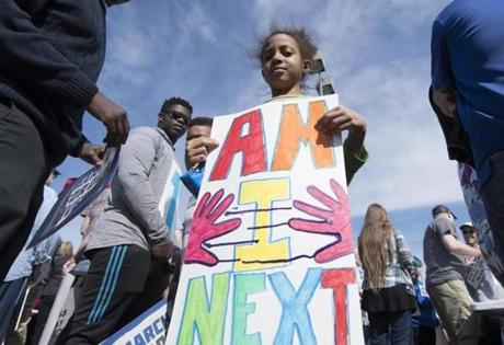 OKLAHOMA CITY, OK - MARCH 24: Alexa Lamb holds a protest sign during the March for Our Lives rally on March 24, 2018 in Oklahoma City, United States. More than 800 March for Our Lives events, organized by survivors of the Parkland, Florida school shooting on February 14 that left 17 dead, are taking place around the world to call for legislative action to address school safety and gun violence. (Photo by J Pat Carter/Getty Images)
