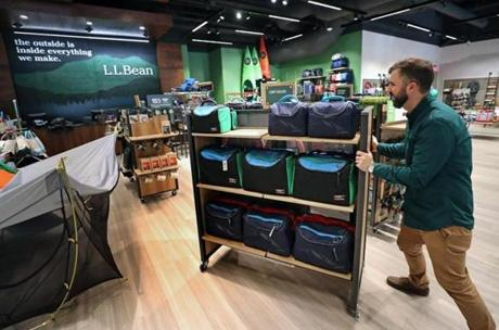 BOSTON, MA - 3/27/2018: Busy work in getting the store ready with employee Case Chandler more shelves. L. L. Bean comes to the Seaport District in Boston which will open April 6th. (David L Ryan/Globe Staff ) SECTION: BUSINESS TOPIC